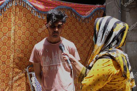 Editorial picture of Relatives of Anum Maqsood visit after plane crash, Lahore, Punjab, Pakistan - 23 May 2020
