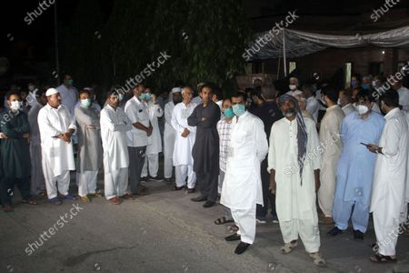 """Pakistani relatives and others offering funeral prayer to pilot Captain Sajjad Gull who was died in plane crash PK 8303, a day after a Pakistan International Airlines aircraft crashed in a residential area in Karachi"""" in Lahore. One of the two people to survive a plane crash in Pakistan that killed 97 people has described jumping from the burning wreckage of the aircraft after it hurtled into a residential neighborhood."""