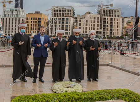 Lebanese Grand Mufti Sheikh Abdul Latif Deryan (C) former Lebanese Prime Minister Saad Hariri (C-L) as they read al-Fatiha in front of the grave of Prime Minister Rafic Hariri, after the end of Eid al-Fitr prayers in downtown Beirut, Lebanon, 24 May 2020. The former Prime Minister, Saad Hariri, had performed the Eid prayer with his supporters in the New Road district of Beirut. Despite the concerns of the Ministry of Health after the spread of the epidemic of the coronavirus disease COVID-19 in previously empty areas, at Beqaa Valley East Lebanon. Muslims around the world are celebrating Eid al-Fitr, the three day festival marking the end of the Muslim holy fasting month of Ramadan. Eid al-Fitr is one of the two major holidays in Islam.