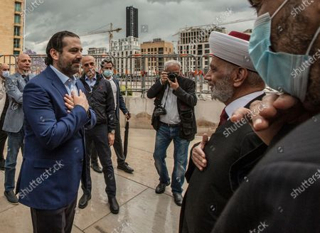 Former Lebanese Prime Minister Saad Hariri (L) welcomes the Lebanese Grand Mufti Sheikh Abdul Latif Deryan (R) as they arrive to read al-Fatiha in front of the grave of Prime Minister Rafic Hariri, after the end of Eid al-Fitr prayers in downtown Beirut, Lebanon, May 24, 2020. The former Prime Minister, Saad Hariri, had performed the Eid prayer with his supporters in the New Road district of Beirut. Despite the concerns of the Ministry of Health after the spread of the epidemic of the coronavirus disease COVID-19 in previously empty areas, at Beqaa Valley East Lebanon. Muslims around the world are celebrating Eid al-Fitr, the three day festival marking the end of the Muslim holy fasting month of Ramadan. Eid al-Fitr is one of the two major holidays in Islam.