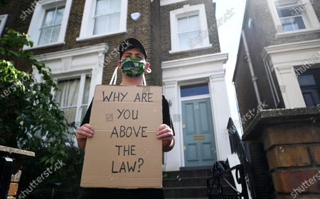 A protester demonstrates outside the home of British Prime Minister Boris Johnson's Special Advisor, Dominic Cummings, in London, Britain, 24 May 2020. Calls for Cummings' resignation have increased since news broke that Cummings breached lockdown regulations while showing symptoms for Covid-19. Countries around the world are taking increased measures to stem the widespread of the SARS-CoV-2 coronavirus which causes the Covid-19 disease.