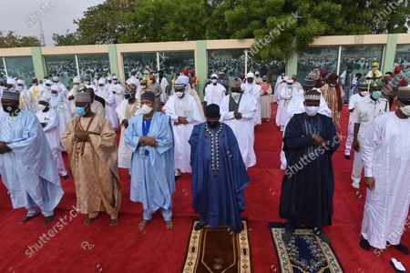 Nigeria Muslims wearing face masks to protect against coronavirus attend Eid prayers at the Kofar Mata prayer ground in Kano Nigeria, . The holiday of Eid al-Fitr, the end of the fasting month of Ramadan, a usually joyous three-day celebration has been significantly toned down as coronavirus cases soar