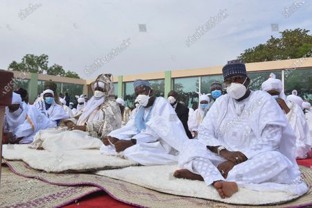 Stock Picture of Nigeria Muslims wearing face masks to protect against coronavirus, attend Eid prayers at the Kofar Mata prayer ground in Kano Nigeria, . The holiday of Eid al-Fitr, the end of the fasting month of Ramadan, a usually joyous three-day celebration has been significantly toned down as coronavirus cases soar