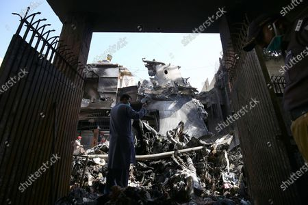 Wreckage of state run Pakistan International Airlines, Airbus A320 is lying amid houses of a residential colony days after it crashed, in Karachi, Pakistan, 24 May 2020. The death toll in a plane crash in Pakistan rose to 97 on 23 May after rescue teams spent the night searching for survivors among the rubble in a residential area in the port city of Karachi, where the state-owned Pakistan International Airlines (PIA) flight with 99 people on board crashed on 22 May.