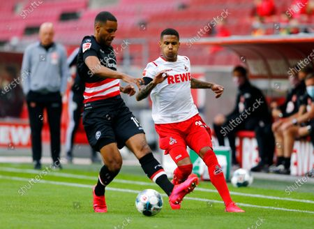 FC Cologne's Ismail Jakobs (R) in action with Fortuna Dusseldorf's Mathias Jorgensen during the German Bundesliga soccer match between FC Cologne and Fortuna Dusseldorf in Cologne, Germany, 24 May 2020, as play resumes behind closed doors following the outbreak of the coronavirus disease (COVID-19).