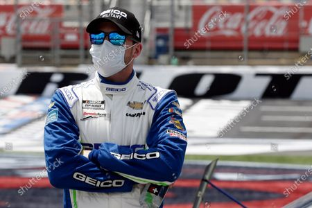Driver Ty Dillon watches on pit road during qualifying prior to the NASCAR Cup Series auto race at Charlotte Motor Speedway in Concord, N.C
