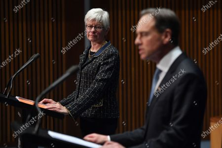 Australia's Deputy Chief Medical Officer (Mental Health) Dr Ruth Vine (L) and Minister for Health Greg Hunt (R) attend a press conference at Parliament House in Canberra, Australia, 25 May 2020. According to media reports, Hunt said that returning to lockdown in case of a future coronavirus outbreak is 'highly unlikely'.