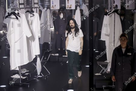 Designer Alessandro Michele walks out at the end of Gucci's Fall/Winter 2020/2021 collection, presented in Milan, Italy. Gucci and St. Laurent are two of the highest profile luxury fashion houses to announce they will leave the fashion calendar behind, with its relentless four-times-a-year rhythm, shuttling cadres of fashionistas between global capitals where they squeeze shoulder-to-shoulder around runways for 15 breathless minutes