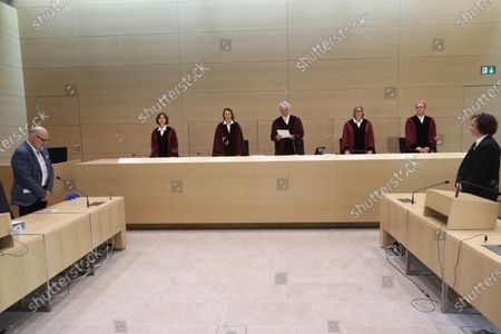Stock Picture of (L-R) Plaintiff Herbert Gilbert and the judges of the German Federal Court, Dr. Stefanie Roloff, Vera von Pentz, Stephan Seiters (Presiding judge), Dr. Christiane Oehler, Dr. Oliver Klein in the German federal court in Karlsruhe, Germany, 25 May 2020. The German federal court (Bundesgerichtshof, BGH) in Karlsruhe issued a verdict in Volkswagen diesel emissions case, and said a customer can hand back to Volkswagen a car equipped with a diesel engine if the engine contained an illegal cheating device. Customer may also demand a partial refund of the purchasing price.