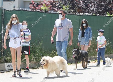 Ben Affleck, Ana de Armas, Violet Affleck, Seraphina Affleck and Samuel Affleck go for a stroll during the Coronavirus outbreak