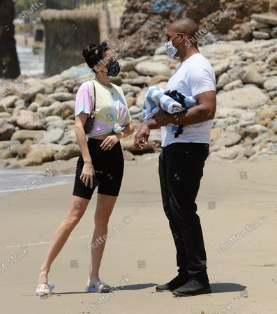 Stock Image of Nicole Williams English and husband Larry English at the beach