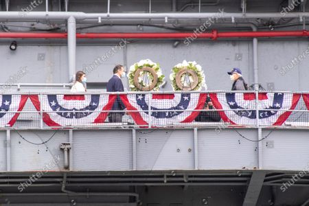 New York Governor Andrew Cuomo, Michaela Cuomo and Stuart Gelband lay a wreath during the Intrepid Sea, Air & Space Museum's virtual Memorial Day ceremony.