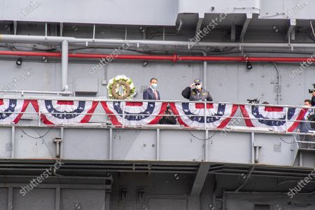 Stock Photo of New York Governor Andrew Cuomo, Michaela Cuomo and Stuart Gelband lay a wreath during the Intrepid Sea, Air & Space Museum's virtual Memorial Day ceremony.