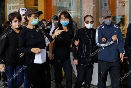 Family members of Macau tycoon Stanley Ho, including Angela Leong On-kei, left, walk out from a hospital, Hong Kong, . Stanley Ho, the dashing billionaire and bon vivant who was considered the father of modern gambling in China, has died, his daughter Pansy Ho said Tuesday. He was 98