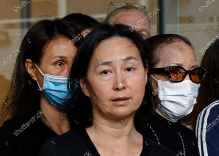 Pansy Ho, center, daughter of Macau tycoon Stanley Ho speaks to the press with Ho's family members outside a hospital, Hong Kong, . Stanley Ho, the dashing billionaire and bon vivant who was considered the father of modern gambling in China, has died, his daughter Pansy Ho said Tuesday. He was 98
