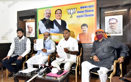Stock Photo of (R to L) MLA from Karawal Nagar constituency Mohan Singh Bisht, Bharatiya Janata Party MLA from Badarpur and Leader of Opposition in Delhi Legislative Assembly Ramveer Singh Bidhuri and MLA from Rohini constituency Vijender Gupta address a press conference at Delhi BJP Office on Pandit Pant Marg, on May 25, 2020 in New Delhi, India.