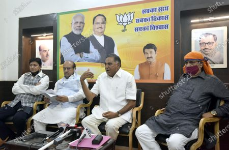 (R to L) MLA from Karawal Nagar constituency Mohan Singh Bisht, Bharatiya Janata Party MLA from Badarpur and Leader of Opposition in Delhi Legislative Assembly Ramveer Singh Bidhuri and MLA from Rohini constituency Vijender Gupta address a press conference at Delhi BJP Office on Pandit Pant Marg, on May 25, 2020 in New Delhi, India.