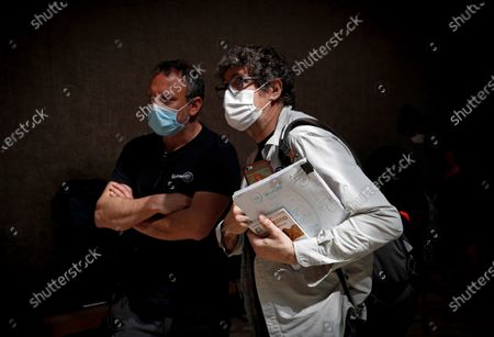 The director of the series 'Tres Caminos' (lit. Three Ways), Norberto Lopez (R), chats with a member of his team while wearing facial protective masks during the filming of the Amazon Prime Video, Ficcion Producciones and Beta Films joint production at Condestable Palace in Pamplona, Spain, 26 May 2020. The series narrates the story of five people of different nationalities that become friends as they walk St James' Way.