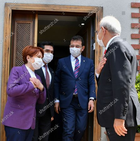 Stock Photo of Turkey's main opposition Republican People's Party, or CHP, leader Kemal Kilicdaroglu, right, says goodbye to Metal Aksener, the leader of IYI (Good) Party, left, after a visit on the End al-Fitr, in Istanbul, . Muslims in the world are marking a muted and gloomy religious festival of Eid al-Fitr, the end of the fasting month of Ramadan _ a usually joyous three-day celebration that has been significantly toned down due to the new coronavirus outbreak. Istanbul Mayor Ekrem Imamoglu is second right