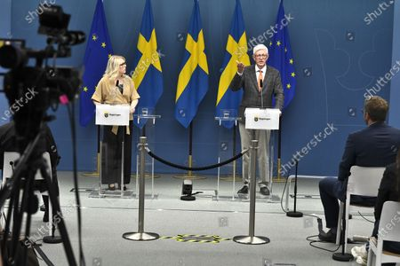 Swedish Minister for Health and Social Affairs  Lena Hallengren (L), and Johan Carlson (R), Director General for the Swedish Public Health Agency, hold a news conference about restrictions for vulnerable 70+ citizens in Sweden, in Stockholm, Sweden, 26 May 2020.