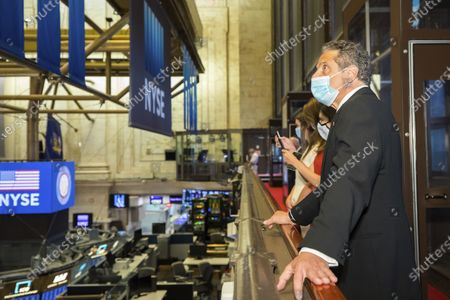 New York State Governor Andrew Cuomo Rings the opening bell New York Stock Exchange President Stacey Cunningham to mark the historic reopening of the NYSE Trading Floor, in New York. New York State Governor Andrew Cuomo will hold his daily press briefing live from the NYSE Board Room