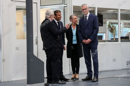 Stock Picture of (L-R) Valeo CEO Jacques Aschenbroich, French President Emmanuel Macron, French Minister for the Ecological and Inclusive Transition Elisabeth Borne and French Economy and Finance Minister Bruno Le Maire visit the factory of manufacturer Valeo in Etaples, near Le Touquet, northern France, 26 May 2020 as part of the launch of a plan to rescue the French car industry.