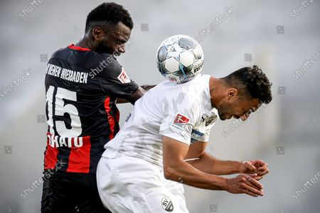 Wiesbaden's Paterson Chato (L) in action against Sandhausen's Aziz Bouhaddouz (R) during the German Bundesliga Second Division soccer match between SV Wehen Wiesbaden and SV Sandhausen at BWT-Stadion Hardtwald in Wiesbaden, Germany, 26 May 2020.