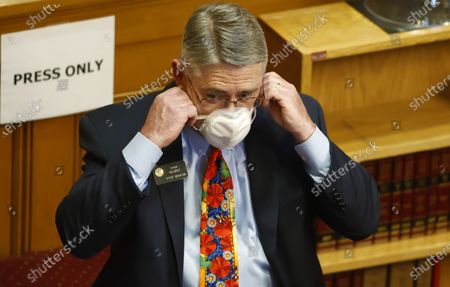 Colorado State Senator Chris Holbert, R-Parker, adjusts his face mask, in Denver. Lawmakers reconvened the 2020 session, which was suspended to deal with the new coronavirus in March, facing the prospect of making deep cuts in the budget Tuesday