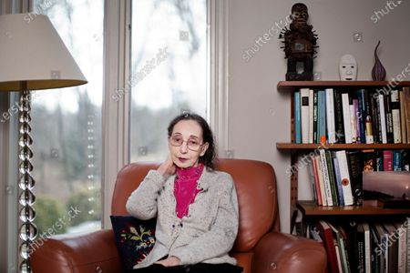 Portrait of American author Joyce Carol Oates at home