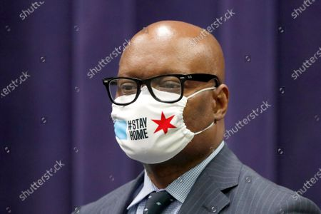 Chicago Police Superintendent David Brown wears a protective mask during a news conference, in Chicago