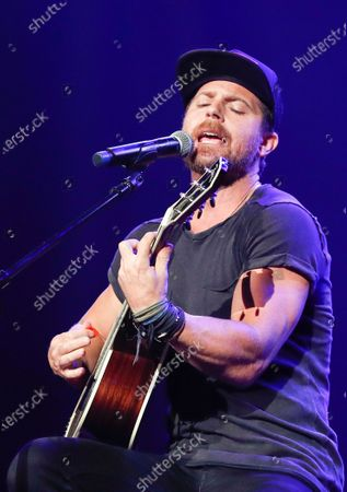"""Kip Moore performing at the 2018 Nashville Songwriters Awards in Nashville, Tenn. Moore was used to traveling the world to surf, rock climb or hike, but lately he's been isolating himself in a remote lodge in eastern Kentucky. The Georgia-born artist releases his new album """"Wild World,"""" in a very chaotic time, but he said his introspective messages might help people right now"""