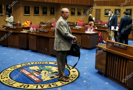 Stock Photo of Sen. Frank Pratt, R-Casa Grande, walks with his briefcase off the Senate floor after the Arizona Senate legislative session was adjourned, in Phoenix. The Arizona Senate's plan to pass a series of House bills and possibly consider two pieces of coronavirus-related legislation were stopped when a majority of members quickly voted to adjourn for the year in a 16-14 vote, with three Republicans joining the Democrats for the majority