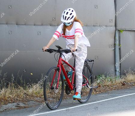 Isla Fisher cycling