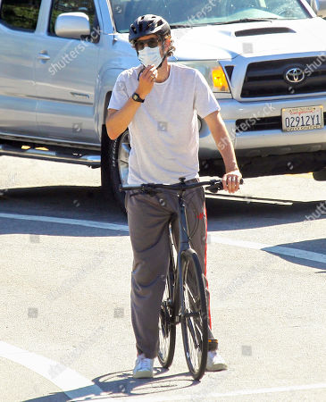 Sacha Baron Cohen cycling