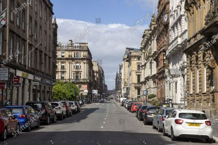 Glasgow City Centre in coronavirus lock down. Centre of Glasgow St Vincent Street normally road full of cars and buses but is empty of moving vehicles
