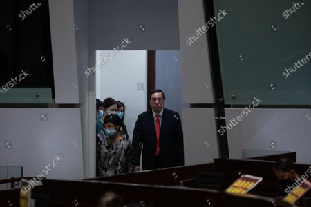 The president of the Legislative Council Andrew Leung (C) enters the chamber to chair a second reading of the National Anthem Bill in Hong Kong, China, 27 May 2020. Under the bill, anyone convicted of misusing or insulting the 'March of the Volunteers' (the national anthem of the People's Republic of China) could face a fine of up to 50,000 Hong Kong dollars (6,449 US dollars) and three years in jail. The bill is expected to be put to a vote on 04 June.