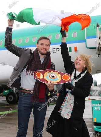 Andy Lee Homecoming, Shannon Airport, Co. Clare 17/12/2014. WBO Champion Andy Lee after arriving back in Shannon Airport greets his mother Ann with the belt