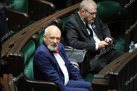 Far-right Confederation leaders Janusz Korwin-Mikke (L) and Grzegorz Braun (R) attend parliamentary debate on the government's anti-crisis shield against the coronavirus pandemic in Sejm (lower house) in Warsaw, Poland, 27 May 2020. Countries around the world are taking increased measures to stem the widespread of the SARS-CoV-2 coronavirus which causes the COVID-19 disease.