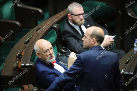 Far-right Confederation leaders Janusz Korwin-Mikke (L), Grzegorz Braun (back) and leader of main opposition party Civic Platform Borys Budka (front) attend parliamentary debate on the government's anti-crisis shield against the coronavirus pandemic in Sejm (lower house) in Warsaw, Poland, 27 May 2020. Countries around the world are taking increased measures to stem the widespread of the SARS-CoV-2 coronavirus which causes the COVID-19 disease.