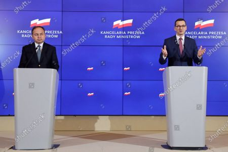 Stock Image of Polish Prime Minister Mateusz Morawiecki (R) and Polish Minister of European Affairs Konrad Szymanski (L) during a press conference at the Chancellery of the Prime Minister in Warsaw, Poland, 27 May 2020. The meeting concerned the current budget offer presented by the European Commission.