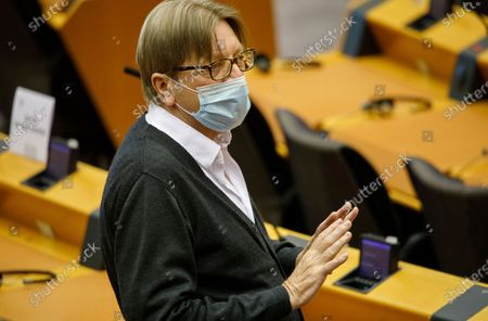 Member of the European Parliament Guy Verhofstadt speaks as he wears a face mask, to protect against the coronavirus, during the plenary at the European Parliament in Brussels, . The European Union is to unveil Wednesday a massive coronavirus recovery plan worth hundreds of billions of euros to help countries rebuild their ailing economies, but the bloc remains deeply divided over what conditions should be attached to the funds