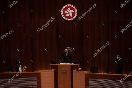Andrew Leung Kwan-yuen President of the Legislative Council of Hong Kong initiates the session at the main chamber. Hong Kong police deployed a security lockdown with about 3,000 officers across Hong Kong's Central area. The measures aim to prevent protests in the surroundings of the Legislative Council building in Admiralty as members of the parliament debate law to criminalise insult to national anthem.