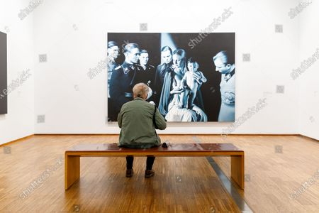 A visitor looks at a painting by Austrian artist Gottfried Helnwein at the Albertina museum in Vienna, Austria, 27 May 2020. The Albertina and the new Albertina Modern reopened under safety measures on 27 May, following a gradual easing of restrictions imposed due to the ongoing pandemic of the COVID-19 disease caused by the SARS-CoV-2 coronavirus.