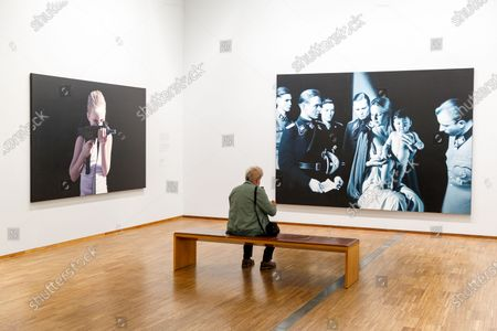 A visitor looks at paintings by Austrian artist Gottfried Helnwein at the Albertina museum in Vienna, Austria, 27 May 2020. The Albertina and the new Albertina Modern reopened under safety measures on 27 May, following a gradual easing of restrictions imposed due to the ongoing pandemic of the COVID-19 disease caused by the SARS-CoV-2 coronavirus.