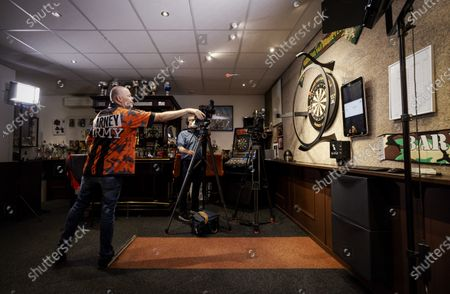 Dutch Raymond van Barneveld is throwing in for a darts match against Britain's Phil Taylor in The Hague, The Netherlands, 27 May 2020. The darters play against each other via a video connection. Taylor plays in Stoke-on-Trent in Great Britain.