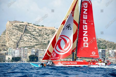 Dongfeng Race Team captained by Charles Caudrelier in action during the Start of Leg 1 with the Santa Barbara Castle on the background