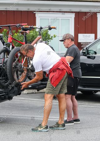 Arnold Schwarzenegger and his friend Ralf Moeller are seen riding bikes