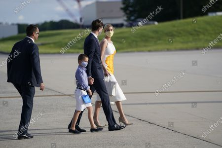 Ivanka Trump walks with White House adviser Jared Kushner and their son Joseph Frederick Kushner after arriving at Andrews Air Force Base, Md., after traveling to Florida, with President Donald Trump