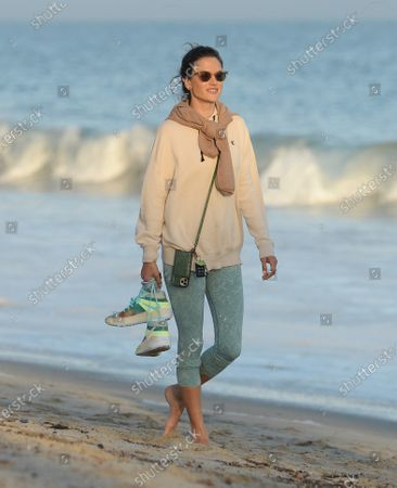 Alessandra Ambrosio takes a sunset walk on the beach, Malibu