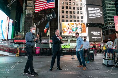Stock Photo of New York, NY - May 27, 2020: Daniel Boulud, John Houghtaling, Andrew Rigie, Tim Tompkins seen when BIG created special advertisement in order to push for speedy opening of small businesses and darken some billboards for 1 minute on Times Square